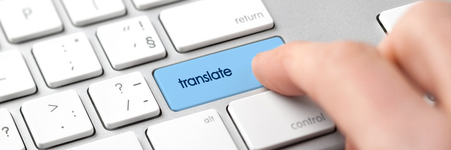 "Concept for machine translation - user pushing a ""translate"" button on a keyboard"